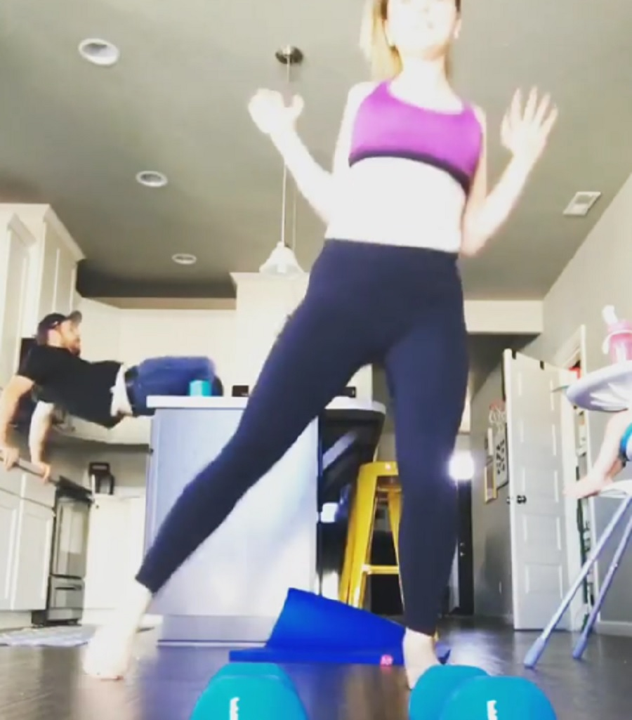 This guy photobombed his wife's workout video, and it did not end well