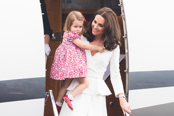 The adorable red shoes Princess Charlotte rocked in Poland are apparently Prince Harry hand-me-downs, and aww