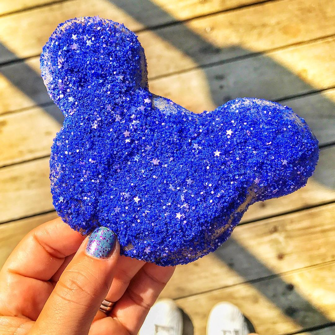 Disneyland is celebrating great news with glittery beignets you can eat