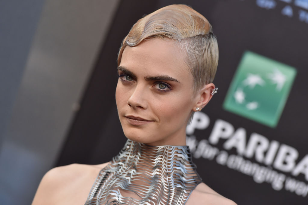 Cara Delevingne thinks she looks like a One Direction member, and we can see it