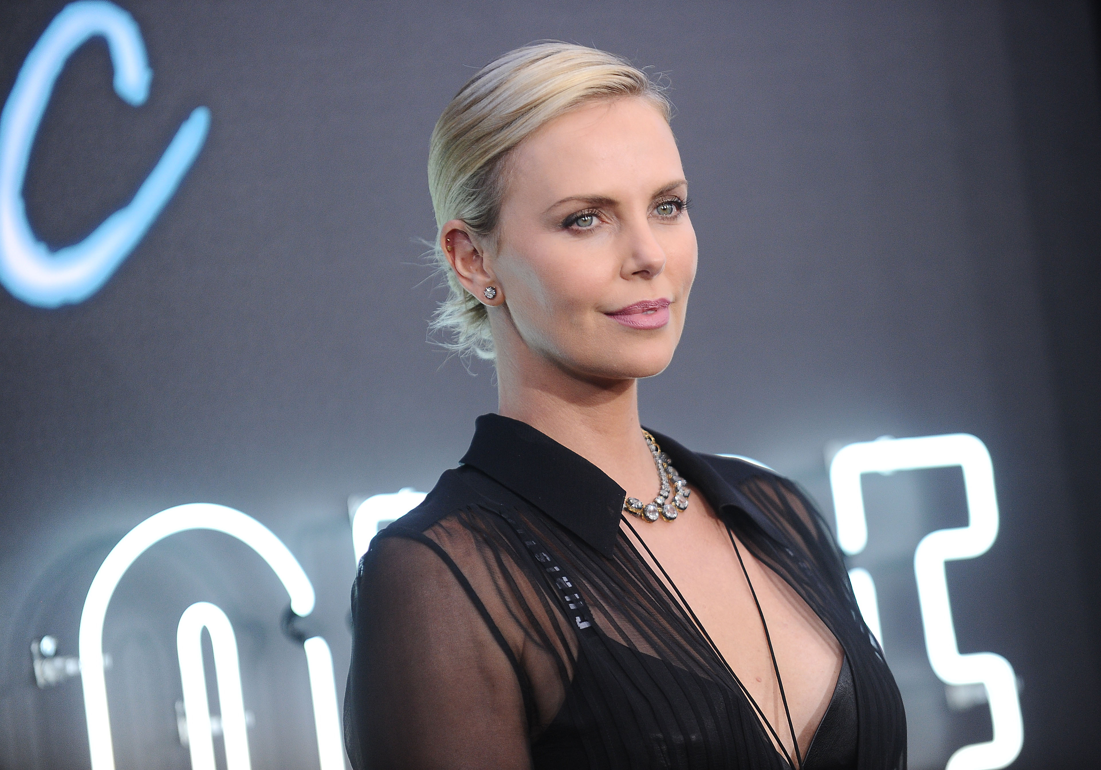 "Charlize Theron wore a sheer dress over a black bra at the ""Atomic Blonde"" premiere in LA"