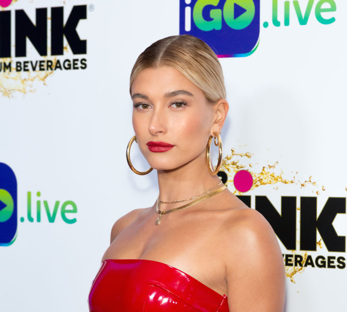 Hailey Baldwin's red mini dress is making us think twice about latex