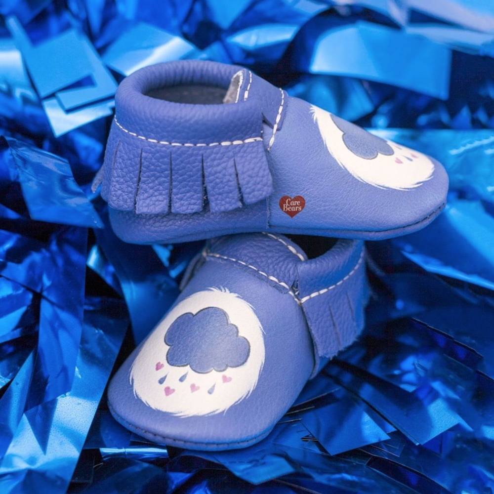This sold-out Care Bears baby shoe collab is back, in case you need a baby shower gift