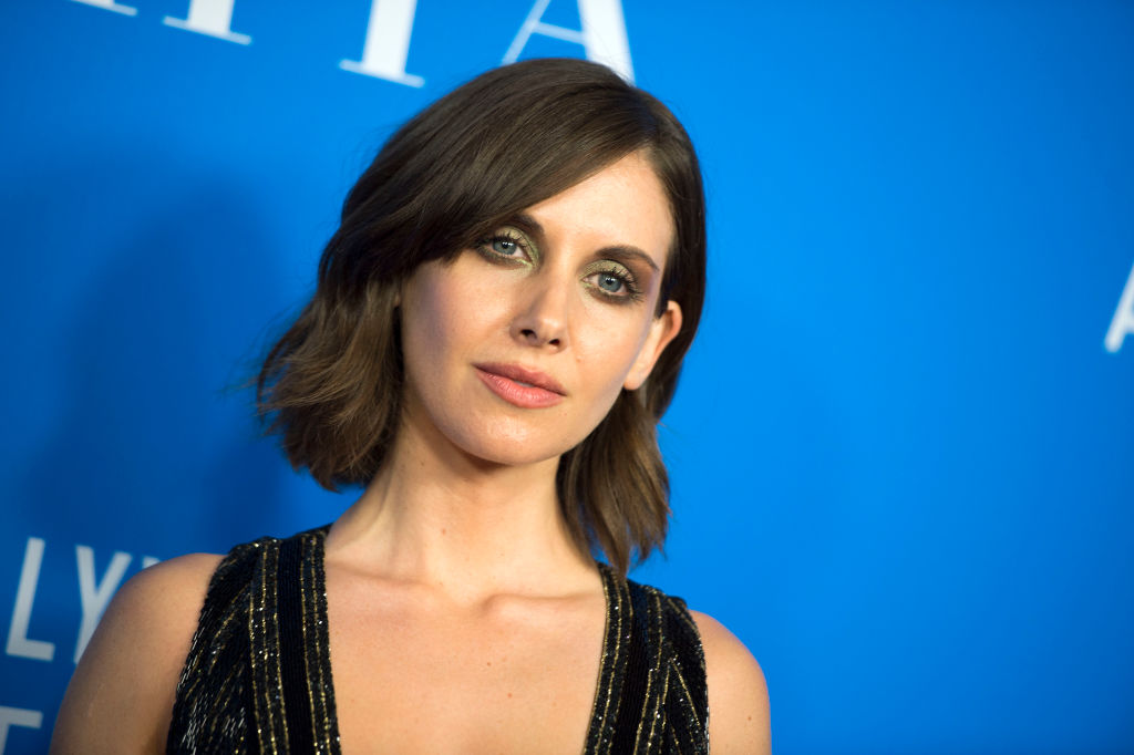 Alison Brie's throwback driver's license photo is not what we expected, but it's so adorable