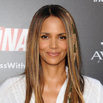 Halle Berry wore a vintage Michelle Obama T-shirt with thigh-high boots, and it's such a lewk