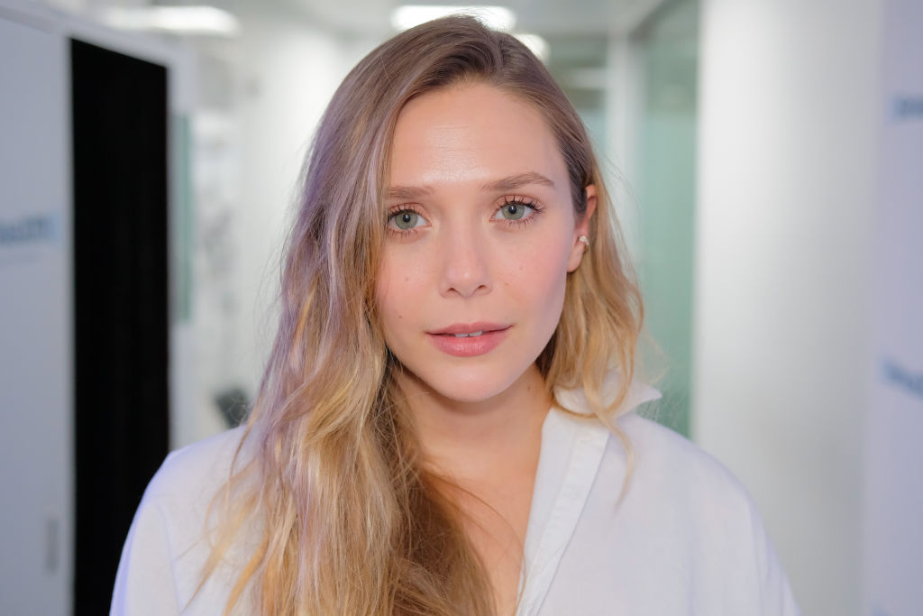 "Elizabeth Olsen proves that the ""pantsuit-dress-cape"" is the new jumpsuit"