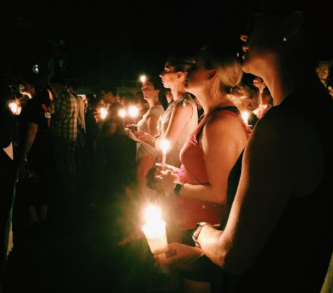 There was an impromptu candlelight vigil in Charlottesville last night, and the pictures are so powerful