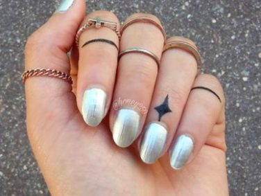 People are getting tiny tattoos on their cuticles, and they look so pretty