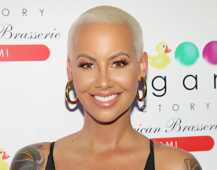 Amber Rose debuted long brown hair, and we're doing a double-take
