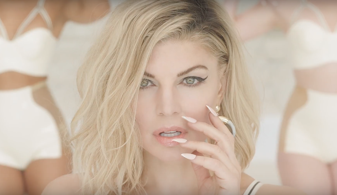 Fergie is coming out with a new album, and we are lining down the block just to watch what she's got