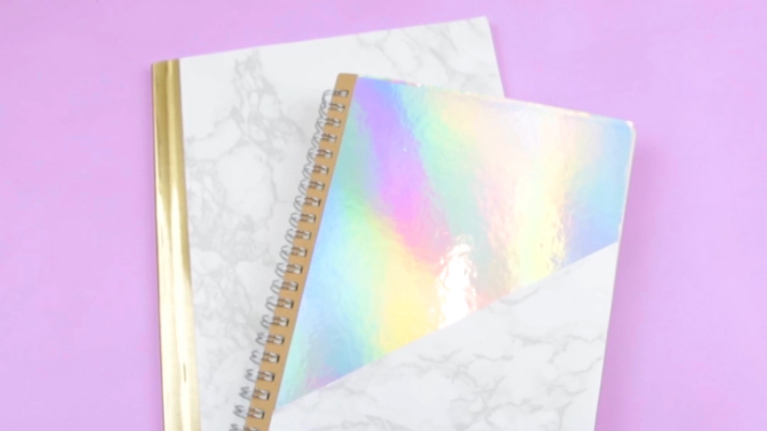 This simple DIY will transform your boring composition notebook into a marbled beauty