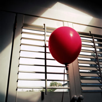 A single red balloon has appeared in the window of Stephen King's home