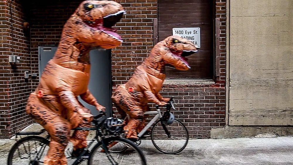 """Dinosaurs just met in DC to protest National Service """"extinction"""" and it was predictably iconic"""