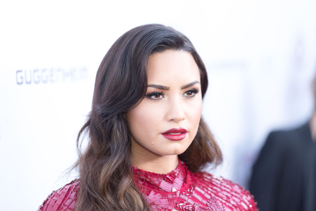Demi Lovato's red dress has a chest cut-out and it's very DRAMA