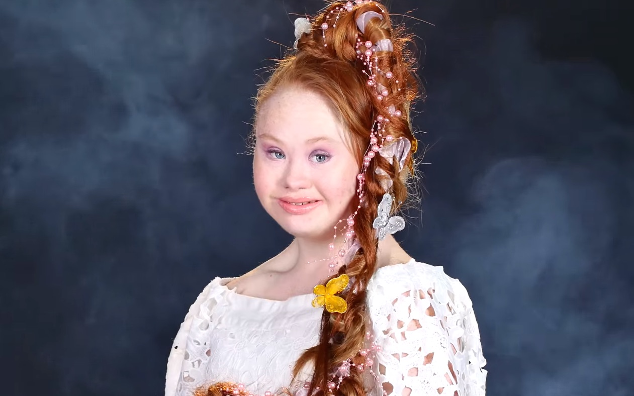 Watch one model with Down Syndrome transform into six gorgeous Disney princesses