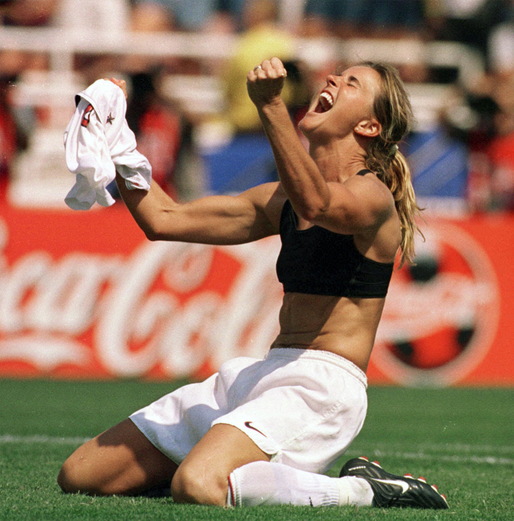 "FILE - In this July 10, 1999 file photo, the United States' Brandi Chastain celebrates by taking off her jersey after kicking in the game-winning penalty shootout goal against China in the Women's World Cup Final at the Rose Bowl in Pasadena, Calif. On Monday Aug. 19, 2013,  Mia Hamm, Julie Foudy and Chastain visited a soccer camp in Manhattan and promoted ""The '99ers,"" the latest in the ESPN Films Nine for IX documentary series that will air Tuesday night.  (AP Photo/The San Francisco Examiner, Lacy Atkins, File)  MANDATORY CREDIT.  SAN FRANCISCO CHRONICLE OUT ORG XMIT: CAEXA301"