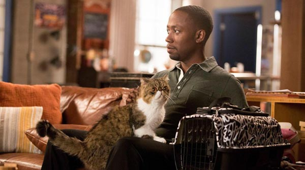 NEW GIRL:  Winston (Lamorne Morris, R) brings Ferguson the cat into the loft in the  Jacooz  episode of NEW GIRL airing Tuesday, Sept. 24 (9:00-9:30 PM ET/PT) on FOX. ©2013 Fox Broadcasting Co. Cr: Jennifer Clasen/FOX