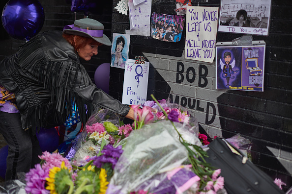 MINNEAPOLIS, MN - APRIL 24:  Prince fans gather at the memorial outside First Avenue nightclub, featured in Prince's 1984 movie Purple Rain on April 24, 2016 in Minneapolis, Minnesota. Prince died on April 21 at his Paisley Park compound at the age of 57.  (Photo by Jules Ameel/Getty Images)