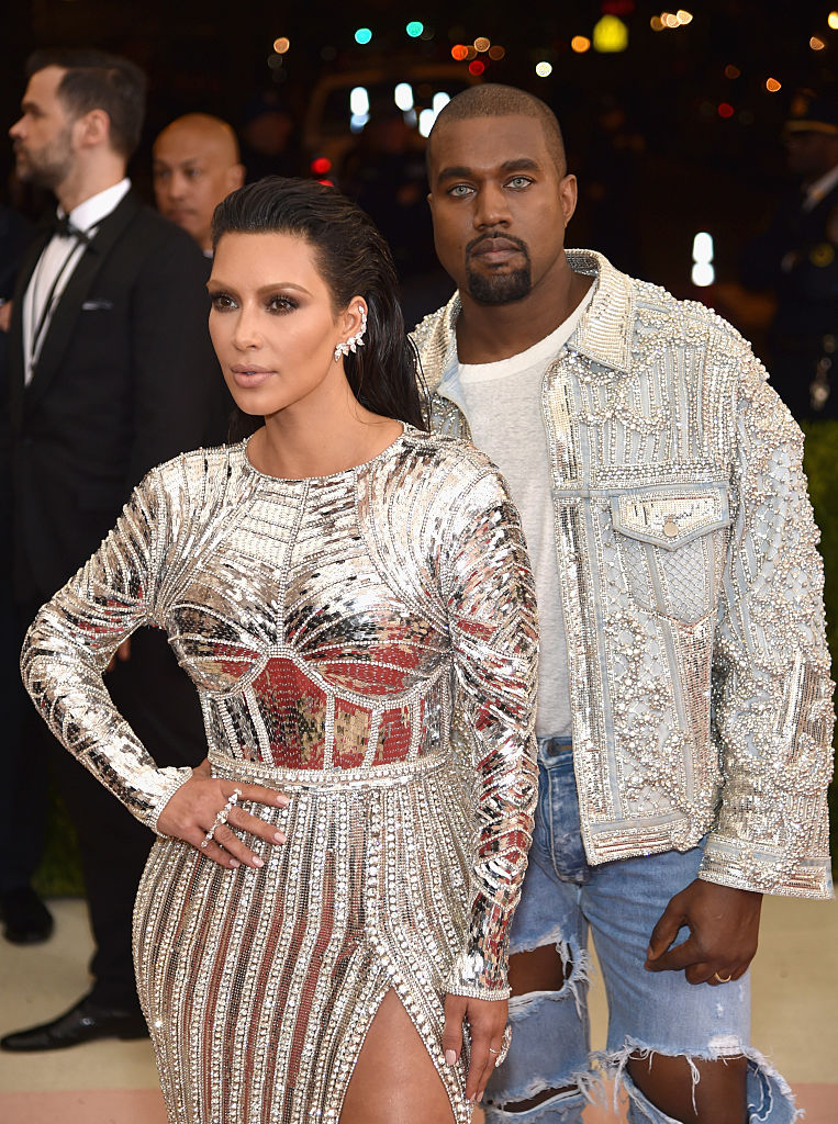 NEW YORK, NY - MAY 02: Kim Kardashian (L) and Kanye West attend the  Manus x Machina: Fashion In An Age Of Technology  Costume Institute Gala at Metropolitan Museum of Art on May 2, 2016 in New York City.  (Photo by Dimitrios Kambouris/Getty Images)