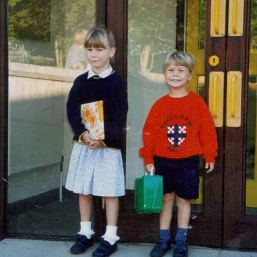 Me (left), around age 5 or 6, in my school's summer uniform