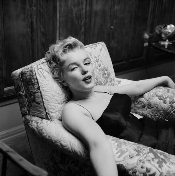 LOS ANGELES - MARCH 3:  Movie star Marilyn Monroe relaxes for a moment during a press party held at her home on March 3, 1956 in Los Angeles, California. (Photo by Earl Leaf/Michael Ochs Archives/Getty Images)