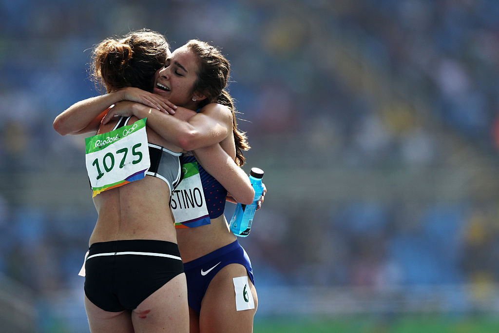 RIO DE JANEIRO, BRAZIL - AUGUST 16:  Abbey D'Agostino of the United States (R) hugs Nikki Hamblin of New Zealand after the Women's 5000m Round 1 - Heat 2 on Day 11 of the Rio 2016 Olympic Games at the Olympic Stadium on August 16, 2016 in Rio de Janeiro, Brazil.  (Photo by Patrick Smith/Getty Images)