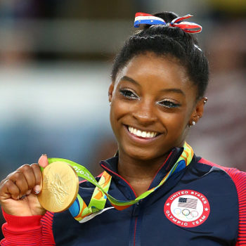 Simone Biles looks like a true Olympian with her gold medal and perfect smile on a Kellogg's cereal box