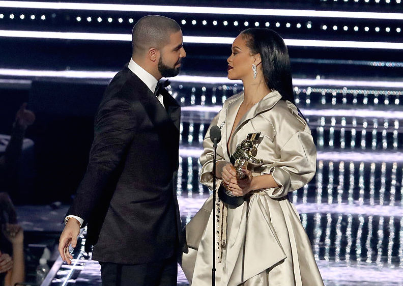 Rihanna leans in to kiss drake as they walk offstage and for Rihanna and drake matching tattoos