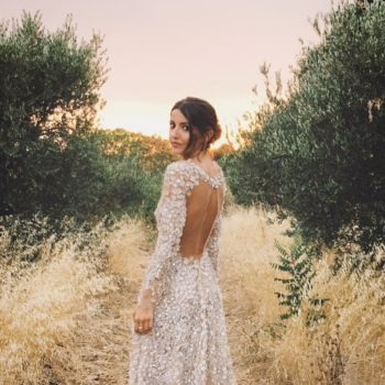 """We would say """"I do!!!!"""" to this sparkly-sheer wedding dress in a heartbeat!"""
