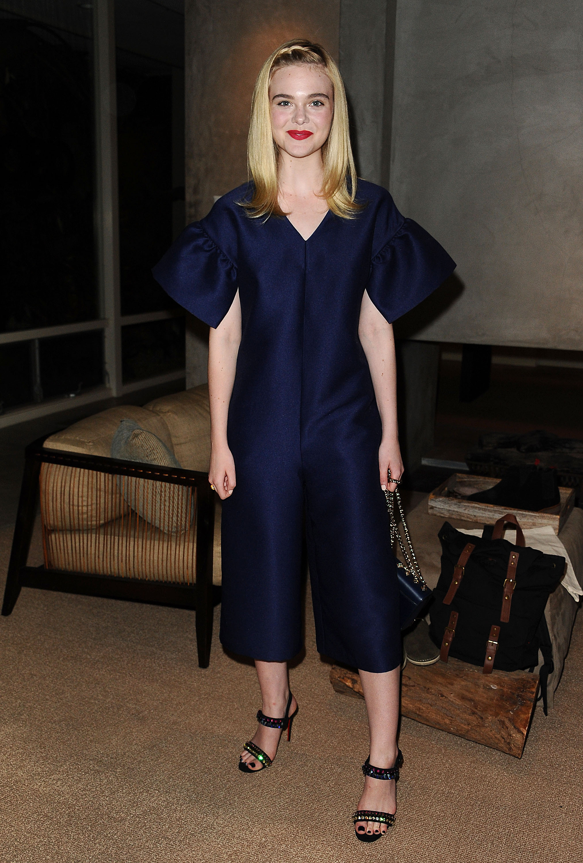 Elle Fanning S Offbeat Jumpsuit Is A Deep Dark Navy Dream And We