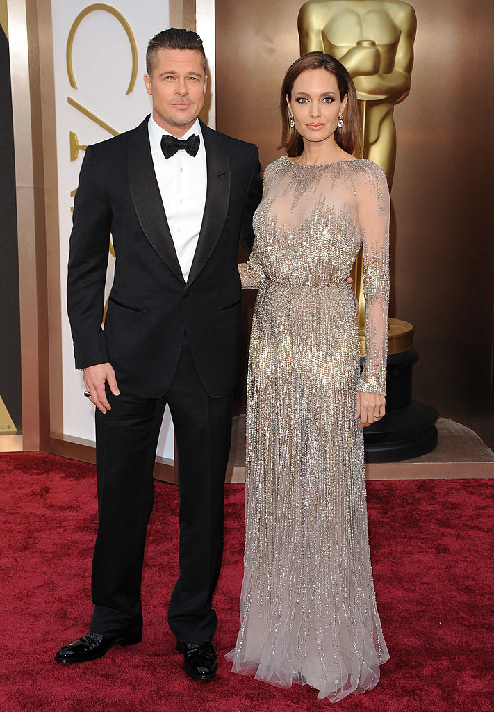HOLLYWOOD, CA - MARCH 02: Actors Brad Pitt and Angelina Jolie arrive at the 86th Annual Academy Awards at Hollywood & Highland Center on March 2, 2014 in Hollywood, California. (Photo by Axelle/Bauer-Griffin/FilmMagic)