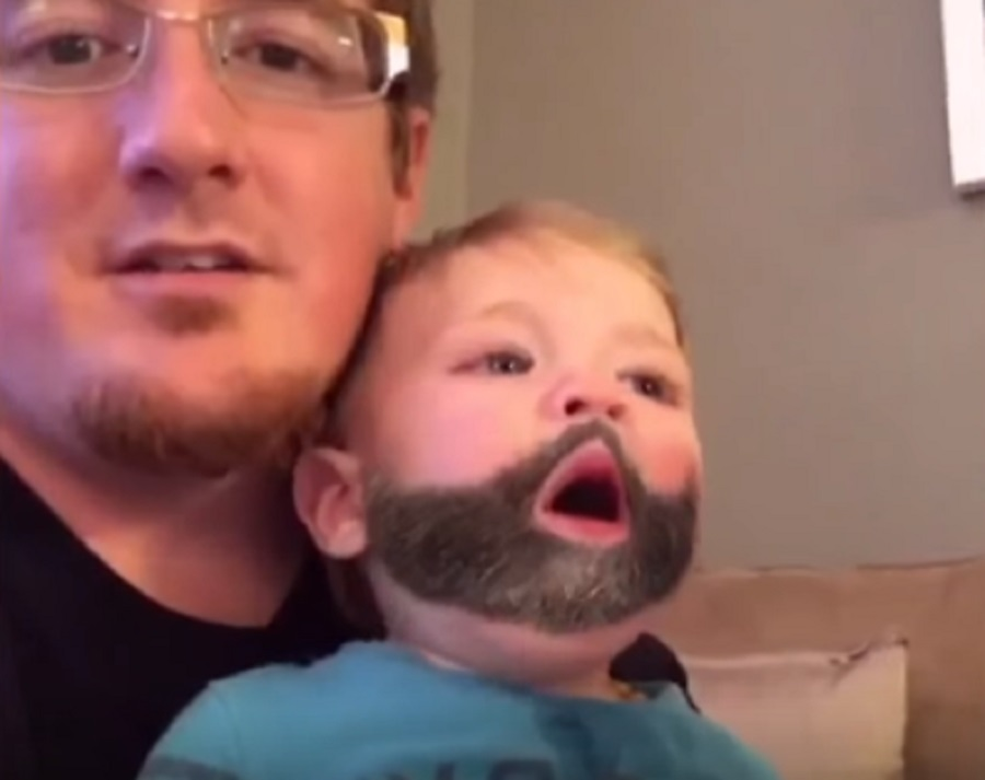 This baby sneezed the Snapchat beard filter onto his dad's face and we can't even handle the cuteness