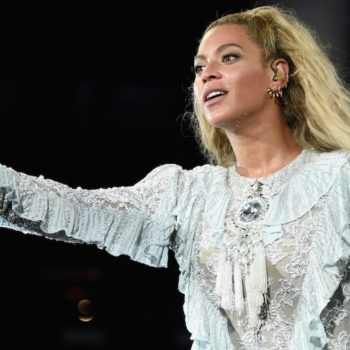 We need Beyoncé's blue knee-high boots immediately — this is not a drill