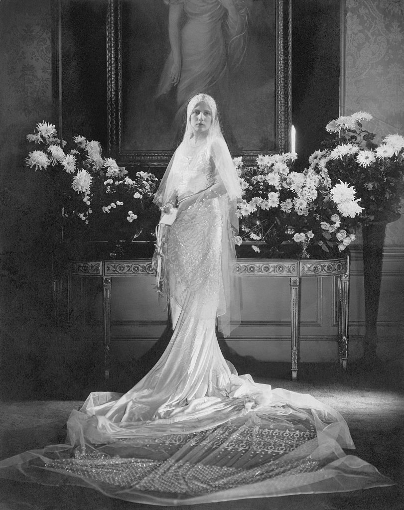 Mrs. Charles Coudert Nast (nee Charlotte Babcock Brown) (Conde Nast's daughter-in-law) wearing wedding dress with very long train and tulle veil swirled on floor before her. (Photo by Edward Steichen/Condé Nast via Getty Images)