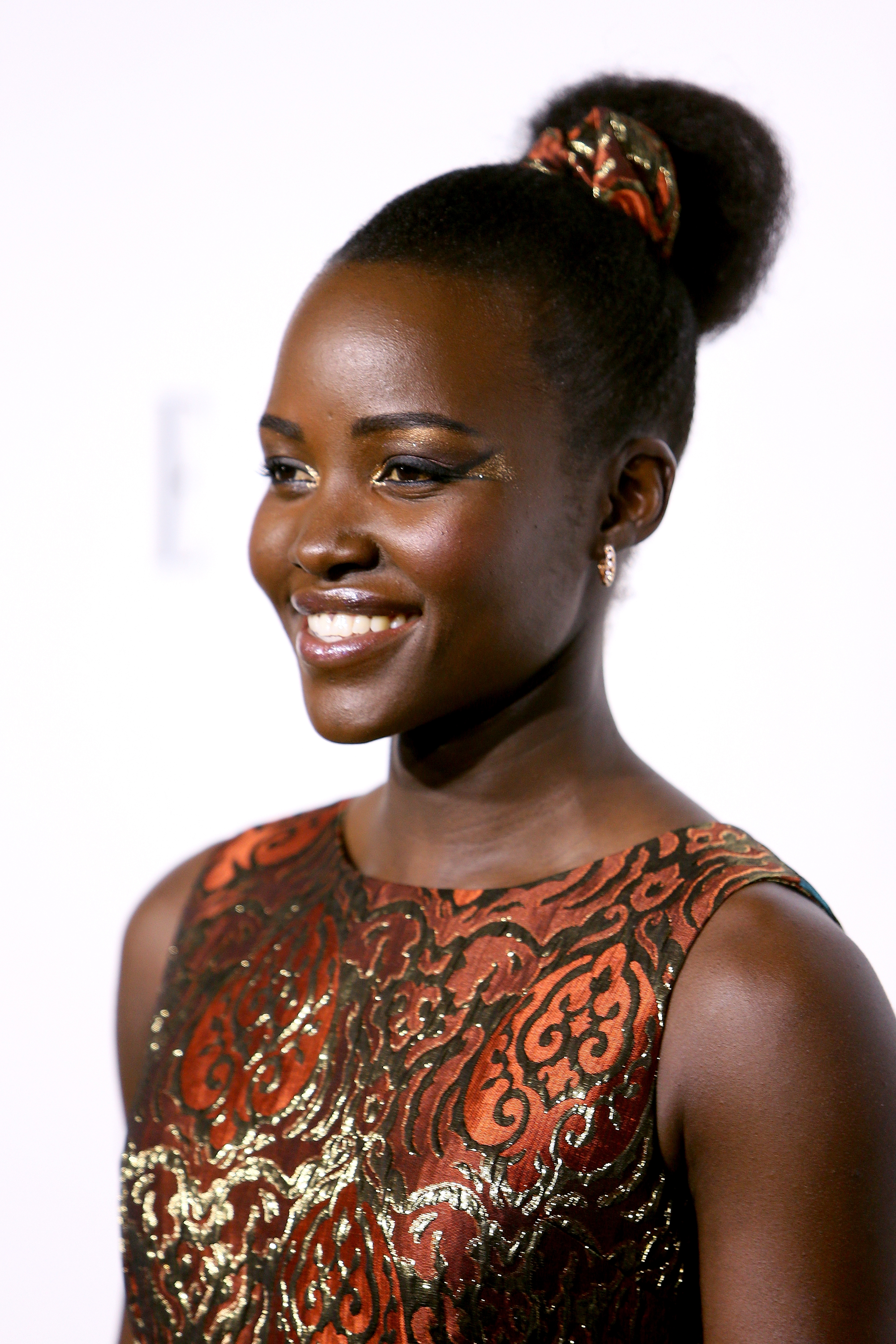 Lupita Nyong'o looks brilliant in her mermaid-style brocade gown