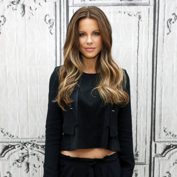 Kate Beckinsale's cat is wearing a costume we do not understand, and yet is rocking it