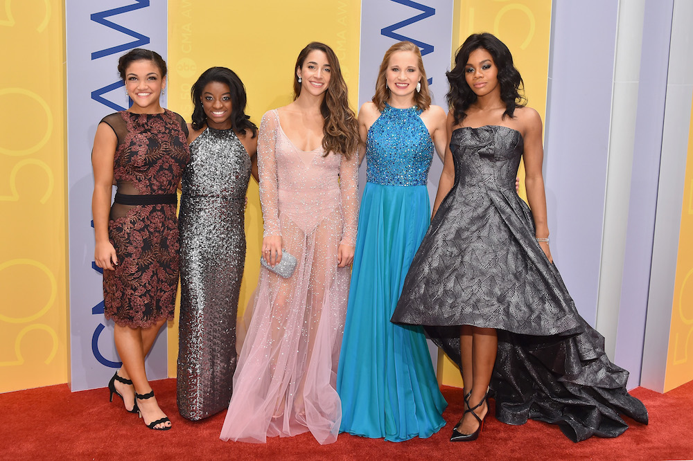 NASHVILLE, TN - NOVEMBER 02: (L-R) Olympic gymnasts Laurie Hernandez, Simone Biles, Aly Raisman, Madison Kocian, and Gabby Douglas attend the 50th annual CMA Awards at the Bridgestone Arena on November 2, 2016 in Nashville, Tennessee.  (Photo by Michael Loccisano/Getty Images)