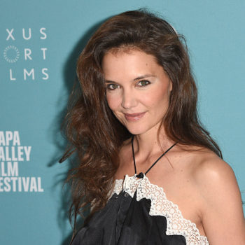 All Katie Holmes needs is a crown to complete this rosy holiday look