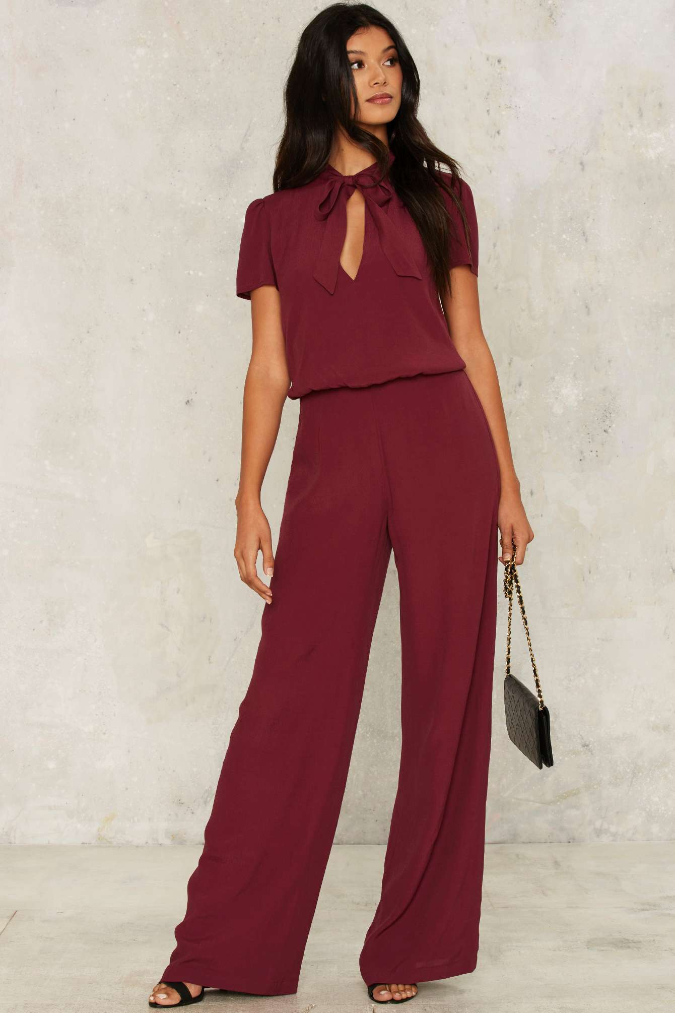 aca3e8ce2a2 Jones To The Rhythm Pussybow Jumpsuit from Nasty Gal