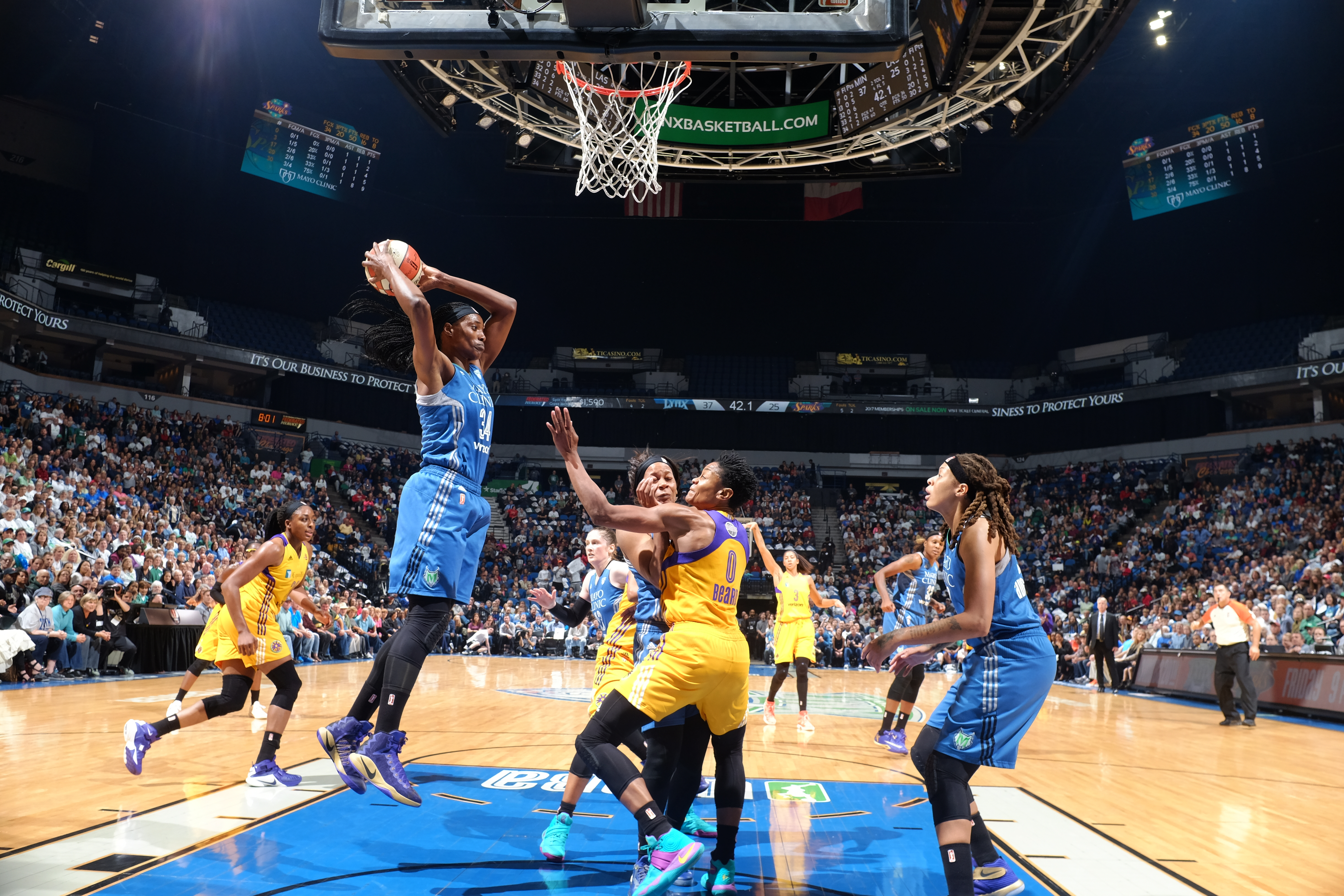 MINNEAPOLIS, MN - OCTOBER 11:  Sylvia Fowles #34 of the Minnesota Lynx grabs the rebound against the Los Angeles Sparks during Game Two of the 2016 WNBA Finals on October 11, 2016 at Target Center in Minneapolis, Minnesota. NOTE TO USER: User expressly acknowledges and agrees that, by downloading and or using this Photograph, user is consenting to the terms and conditions of the Getty Images License Agreement. Mandatory Copyright Notice: Copyright 2016 NBAE (Photo by David Sherman/NBAE via Getty Images)