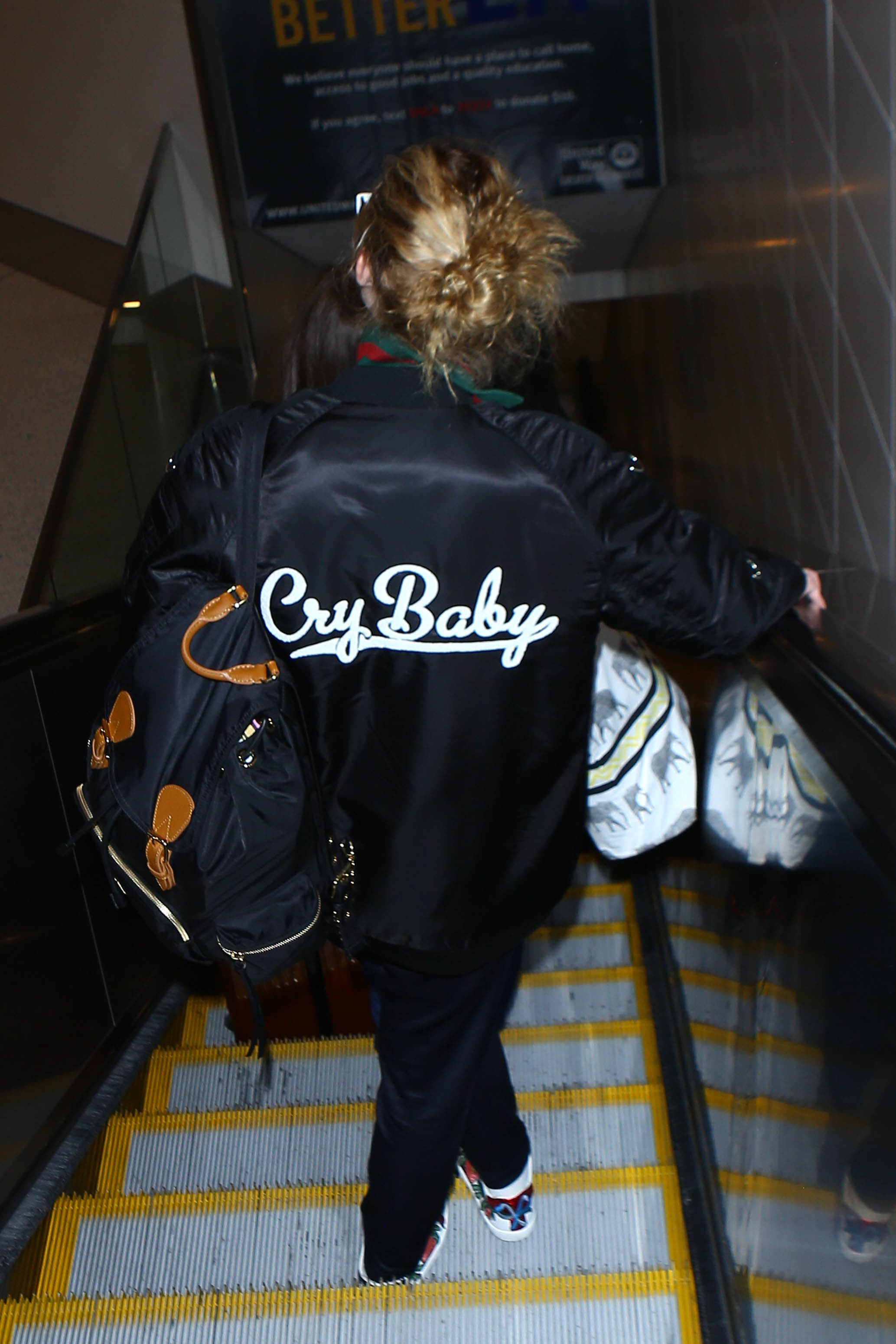 78ff344eb8b1 We feel deeply connected to what the back of Elle Fanning s jacket ...