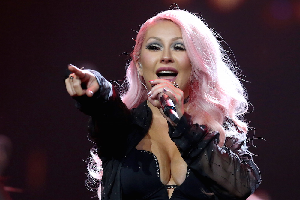 christina aguilera proves that pink makes a perfect christmas color too