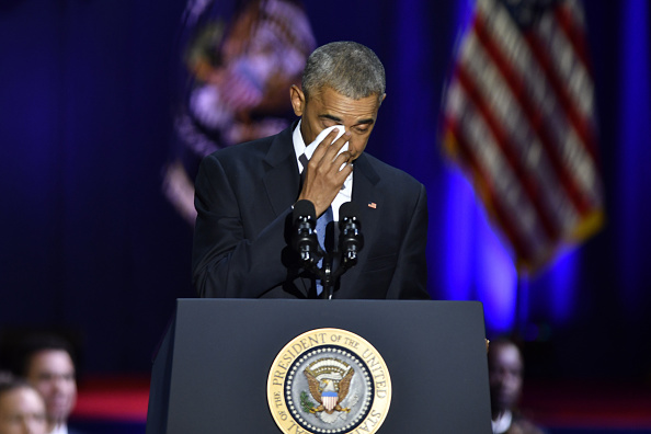 U.S. President Barack Obama wipes his tears while speaking about U.S. First Lady Michelle Obama, not pictured, during his farewell address in Chicago, Illinois, U.S., on Tuesday, Jan. 10, 2017. Obama blasted  zero-sum  politics as he drew a sharp contrast with his successor in his farewell address Tuesday night, acknowledging that despite his historic election eight years ago his vision for the country will exit the White House with him. Photographer: Christopher Dilts/Bloomberg via Getty Images