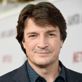 Nathan Fillion appears to be trapped in a disco party bus and his look says it all