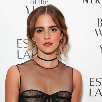 Emma Watson looks perfectly Parisian in this beret and checkered pea coat