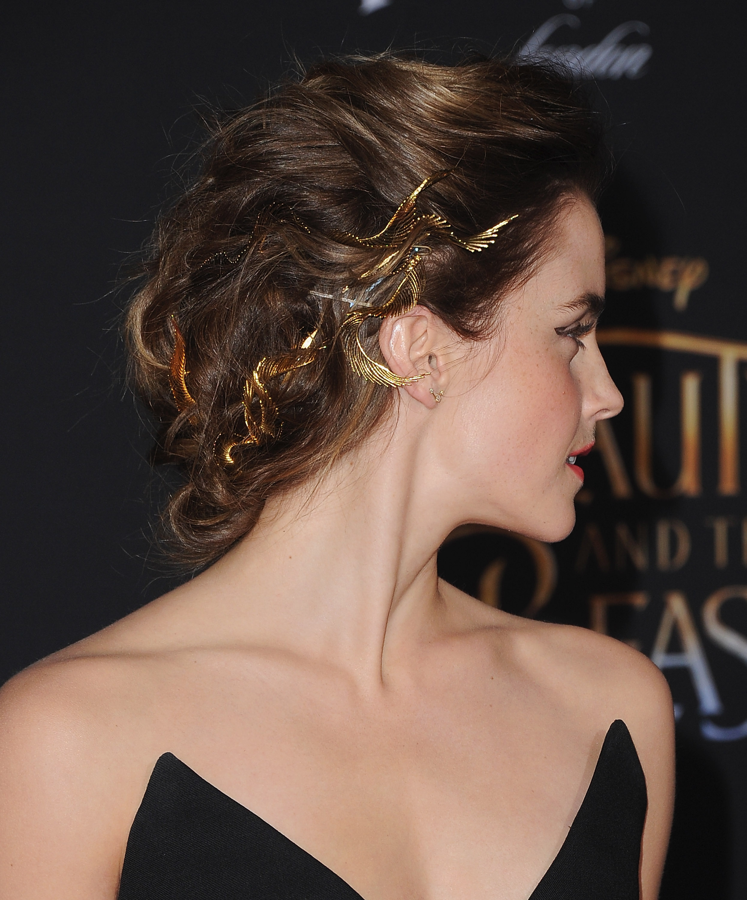 Emma Watson goes for the gold with a hair accessory styled ...