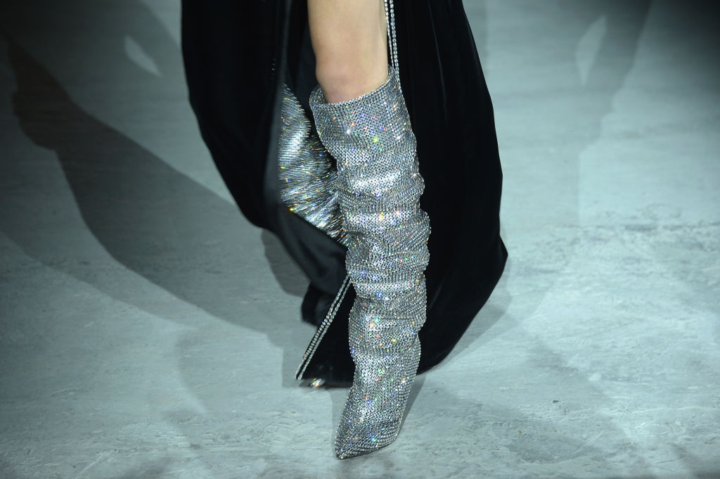 64bde5f39fc Those Saint Laurent glitter boots cost more than some cars — and there's  already a waitlist for them - HelloGiggles