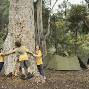 My kids are (literal) tree huggers, and this is how I'm raising them to care for our planet