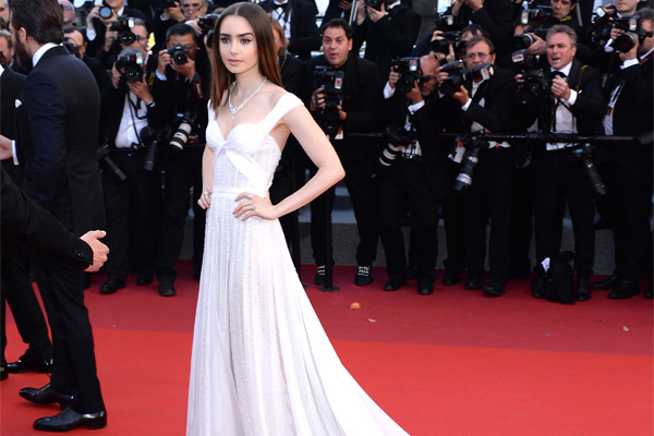 d80dd6bdbc Lily Collins glimmered in a sheer dress that looks like it s made ...