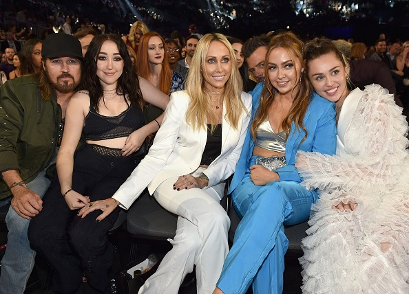miley, noah, billy, and fish cyrus in the audience at the billboard music awards.